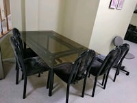 Glass dining table with 6 chairs rarelyused Germantown, 20874