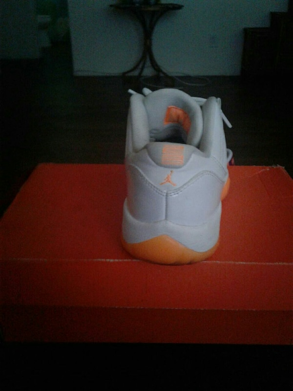 new concept 0ae04 39cce Used unpaired white and orange Air Jordan 11's for sale in ...