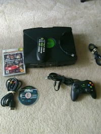 black Xbox 360 console with controllers and game cases Lombard, 60148