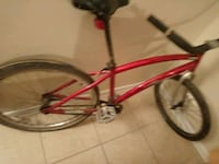 red and black cruiser bike 646 mi