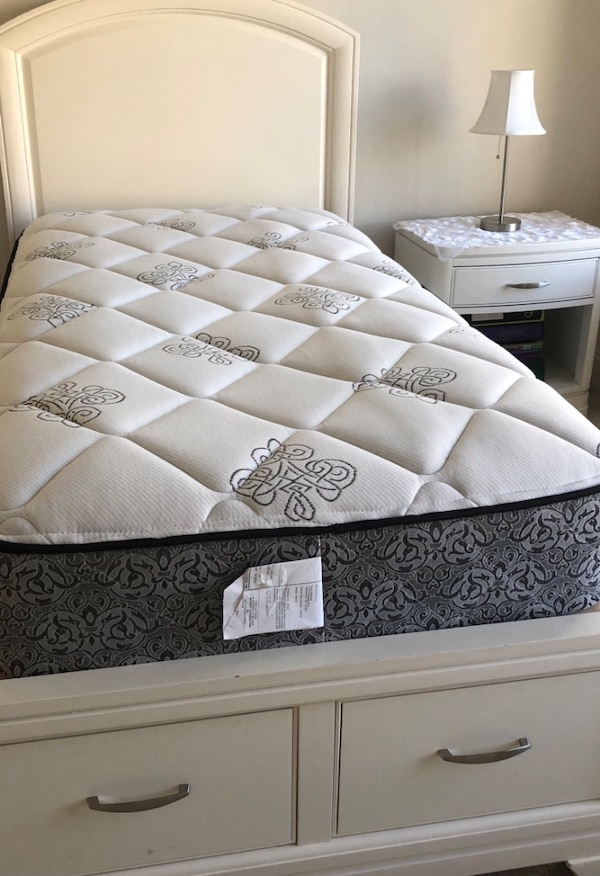 Twin bed frame with new mattress
