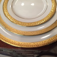 White and gold China service for 16. (2 coffee cups missing). Includes several large bowls and serving platter.  Dinner plate, salad, dessert, cup, saucer, soup bowl. Excellent condition. No gold wear. Cockeysville, 21030