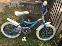 toddler's blue and white bicycle AJAX