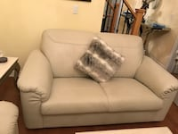 Neutral color leather large love seat  561 km