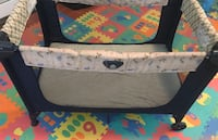 gray and black travel cot