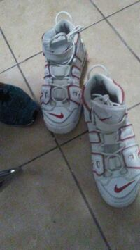 pair of white-and-gray Nike sneakers