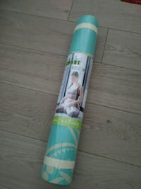 Brand new yoga mat with carrying strap