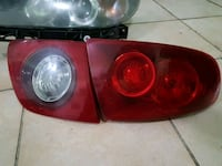 two red-and-black car headlights Dollard-des-Ormeaux, H9B 1K5