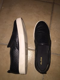 pair of black-and-white Adidas sneakers 784 km