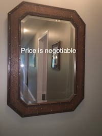 Mirror refinished with a brown overlay and a beige undertone to give a vintage look Guelph, N1E 0H8