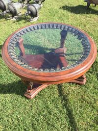 Round brown wooden framed glass top coffee table Kenly, 27542