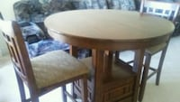 Bar height dining table with 2 chairs
