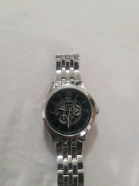 round silver-colored chronograph watch with link bracelet 369 mi
