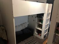 Bunk bed with built in closet and shelves, comes with twin mattress. Hamilton, L9A 1B8