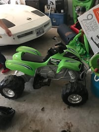 Green and white ride on atv electric with charger works great  Johnston, 02919