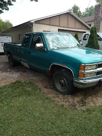 teal extended cab pickup truck