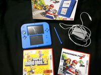 blue Nintendo 3DS with game cases Brampton, L6Y 4T3