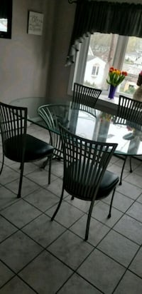 black metal framed glass top table with chairs Revere, 02151