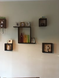 five brown wooden wall-mounted shelves San Antonio, 78217