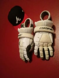 pair of white Brine gloves Orlando, 32811