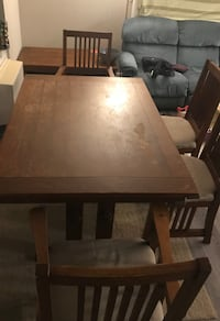 Solid wooden dining table with 4 chairs