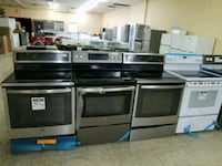 Glass top electric stove stainless steel and white Barrie, L4N 4T8
