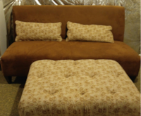 brown love seat with 2 pilliows and large ottermon null