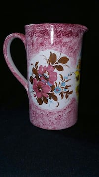 pink and white floral ceramic pitcher