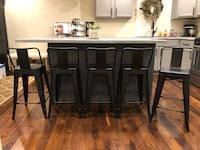 """FIVE matte black counter height (24"""" tall from floor to seat) barstools with backs. Has some lighter wear and scuffs. $160/all Bourbonnais, 60914"""