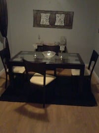Glass top table , chairs and shag rug. Calgary, T2K 4G2