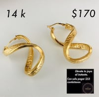 gold-colored ring with text overlay Miami, 33135