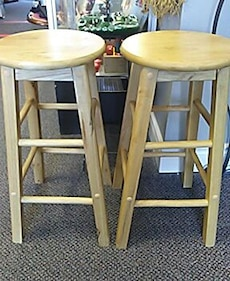 two round brown wooden stools