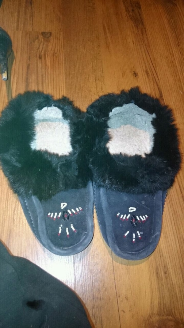 pair of black-and-white fur boots