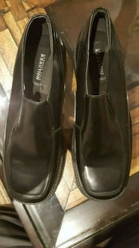 pair of black leather flats 542 km