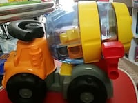 orange, grey, and yellow cement mixer truck toy Land O' Lakes