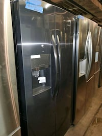 Side by side doors fridge NEW scratch and dent  Baltimore, 21223