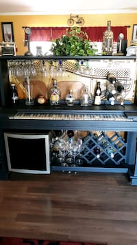 Old Piano refurbished into a bar with wine cooler.  Moyock, 27958