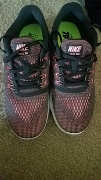 pair of black-and-pink Nike running shoes Denver, 80205