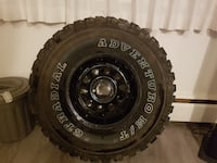 black bullet hole car wheel with tire SURREY