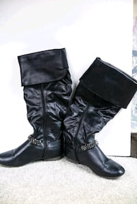 Pair of black leather knee-high boots St. Albert, T8N 5T8