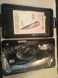 New Men's Remington Grooming Kit containing new tools including container.