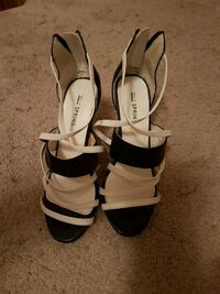 pair of white-and-black leather sandals Maple Ridge, V2W 1B4