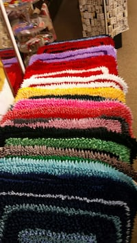 red, green, and white polyester knit rugs CHAMBERLAIN