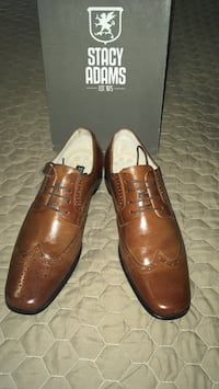 Pair of brown leather dress shoes Simpsonville, 29681