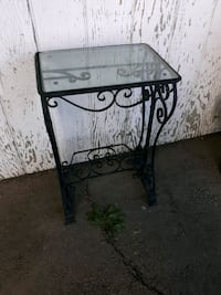 Indoor outdoor iron table with glass top