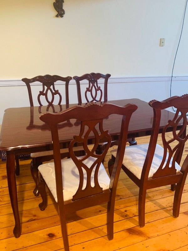 Dinning table with cushioned chairs