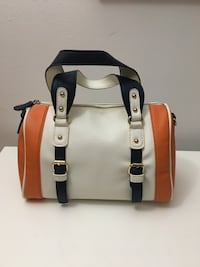 white, orange, and black leather tote bag