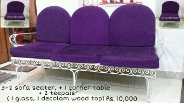 two purple and pink fabric sofa chairs