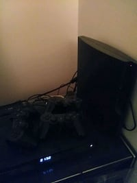 black Sony PS3 game console Longueuil, J4J 3G2