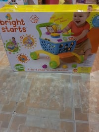 blue, white, yellow, and green Bright Starts 4-in-1 shop 'n cook walker box